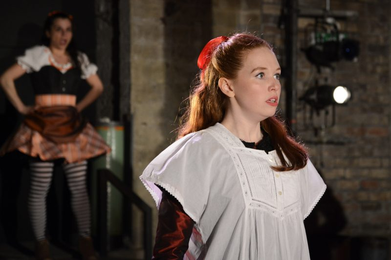 Vanessa Schofield (foreground above) is outstanding as Louisa, schoolmaster Gradgrind's dutiful daughter, as is Suzanne Ahmet (in the background) as the spirited circus girl Sissy Jupe.
