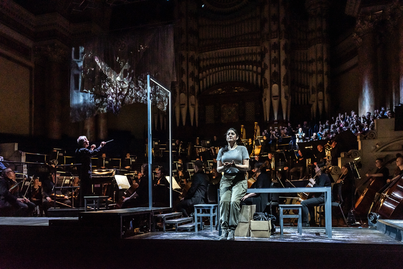 Opera North's Aida, Spring 2019   Alexandra Zabala as Aida with the Chorus and Orchestra of Opera North Conductor Sir Richard Armstrong, Director Annabel Arden, Designs and Video Direction Joanna Parker, Video Design Dick Straker, Lighting Designer Richard Moore Photo credit: Clive Barda
