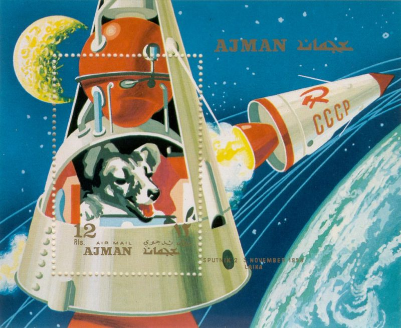 Postage stamp of Laika in space.