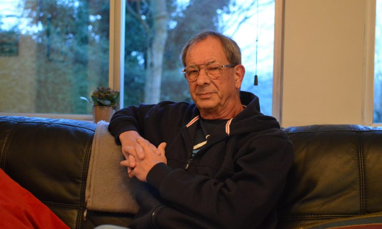 Author Chris Nickson relaxing on a couch at home